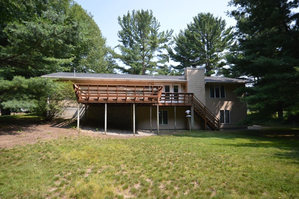 Back of the house showing the large deck and yard for the kids to play in