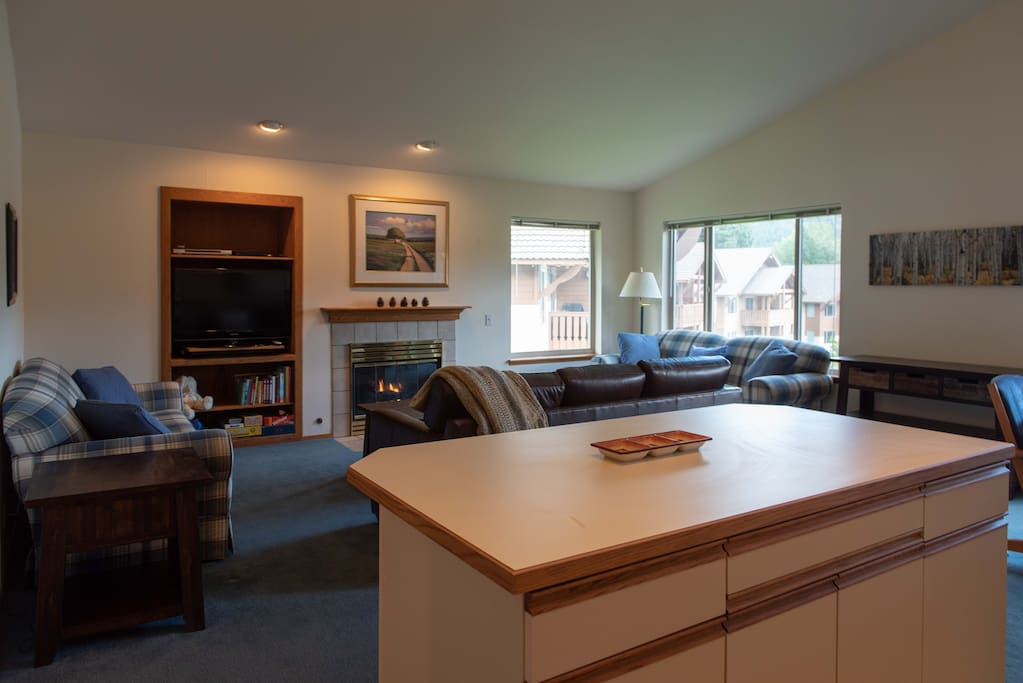 You wont miss anything while you are in the kitchen. Note breakfast bar island with seating, gas fireplace and HD TV with cable, dvd player & games too.