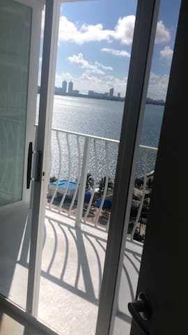 Suite with balcony water view in North Bay Village