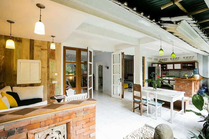 Spacious semi-open air living/dining room attached with minimalist kitchen