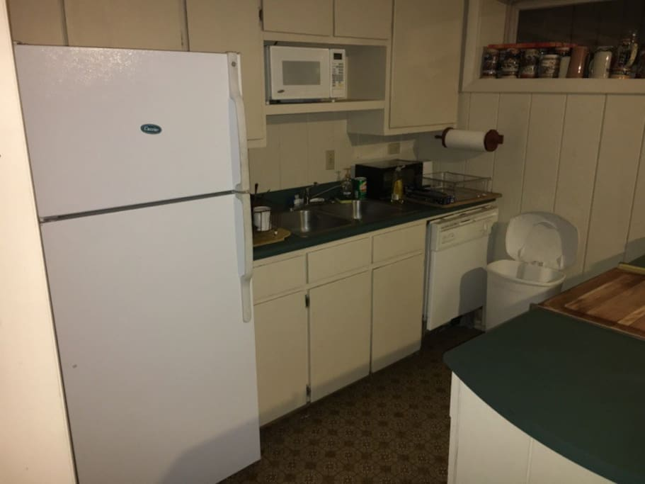 Kitchen with most appliances and utensils needed