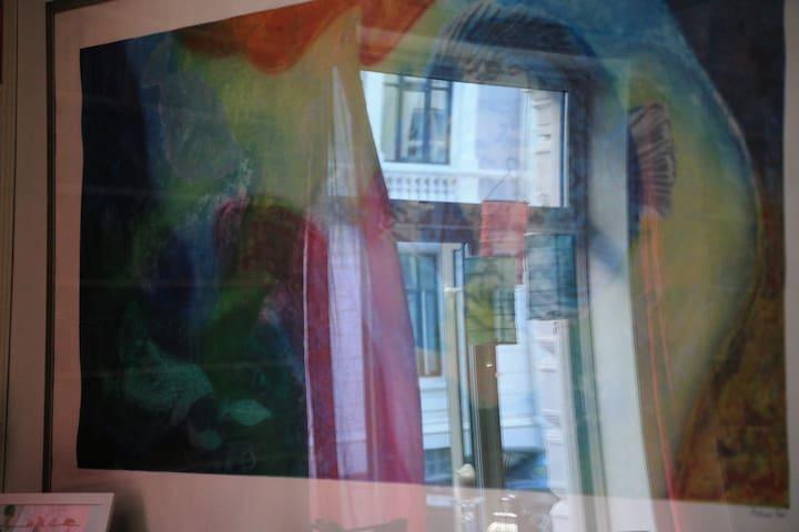 Art details, reflecting living room windov.