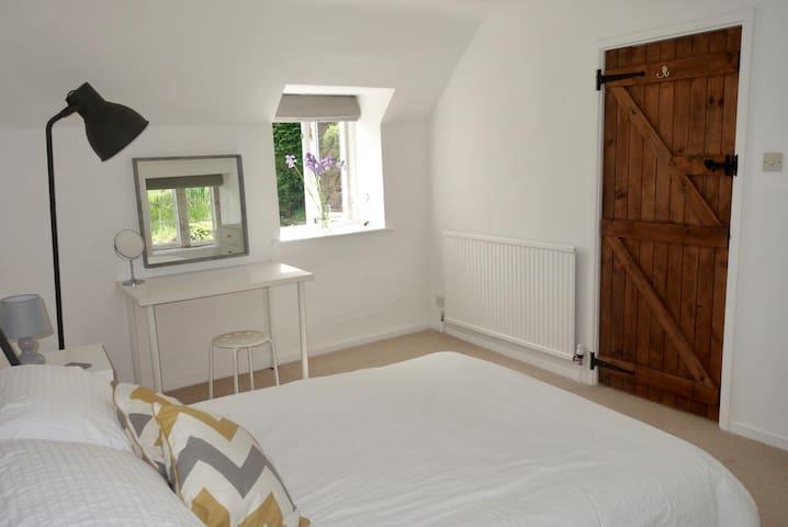 Light & airy dual aspect bedroom