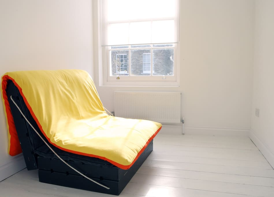 futon bed in spare room
