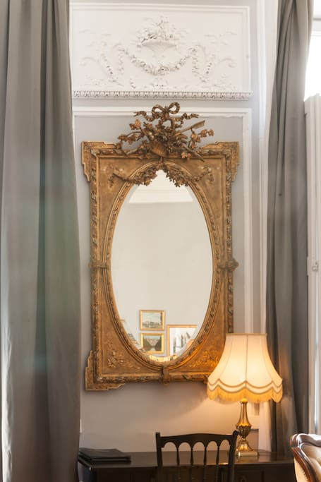 Classic French decor in a gorgeous historical 1600's apartment with grey walls and white moldings in Carcassonne. #vacationrental #French #classicFrench #Paris #Frenchdecor