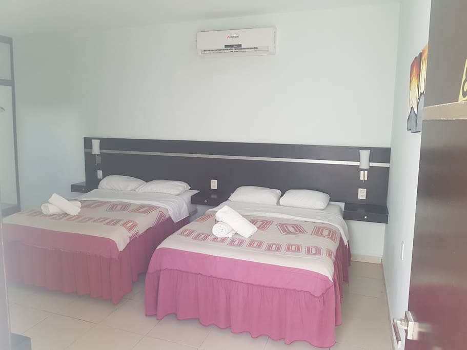 Habitación doble con camas matrimoniales