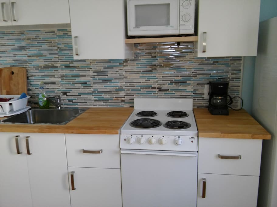 Butcher block counter, new cabinets and tile back splash