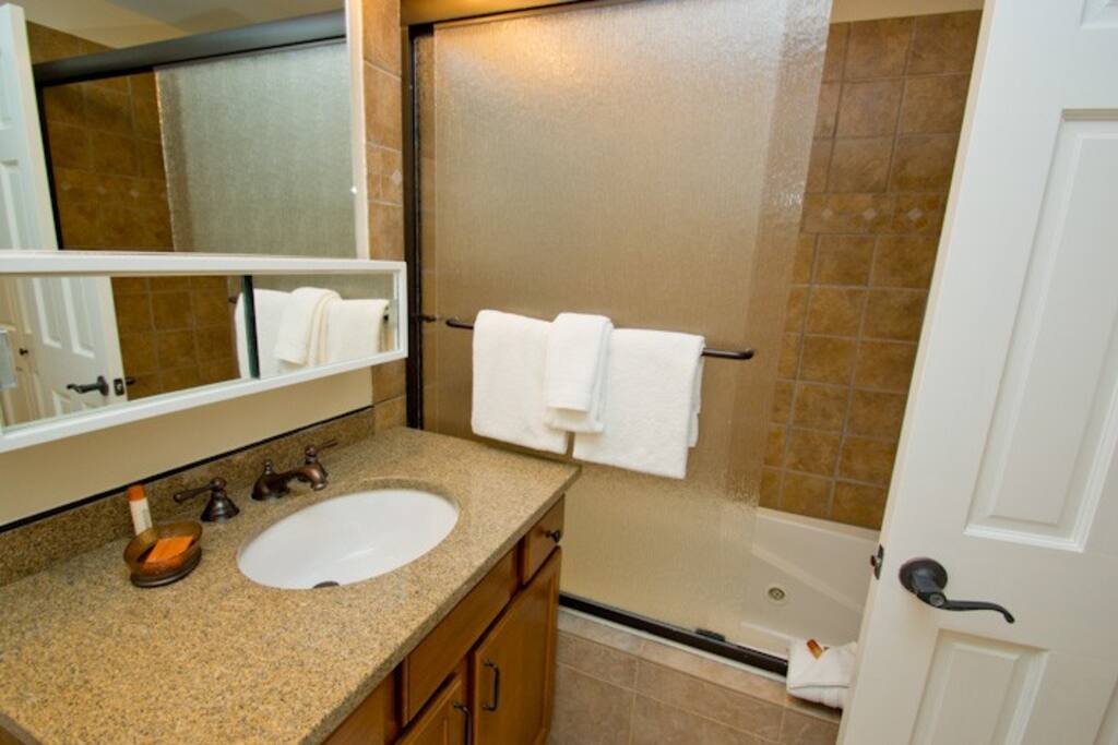 The guest bathroom on the main level has a combined shower & tub.