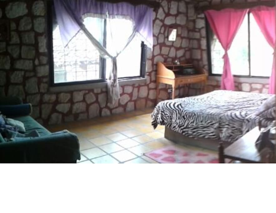 One of our 4 bedrooms. It has its own personality! :)