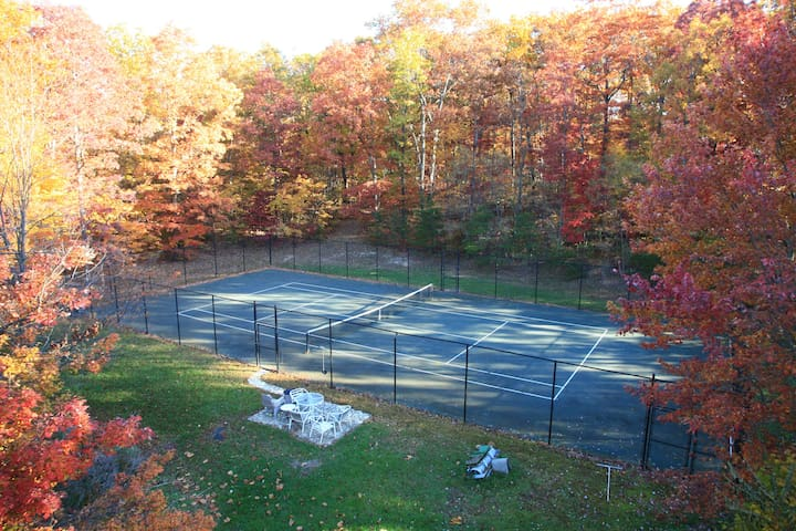Clay tennis court, with plenty of room for fans!