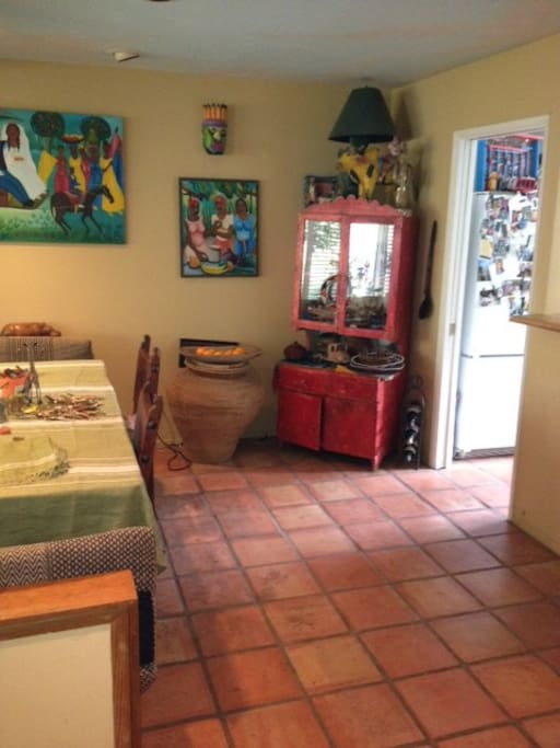 Diningroom close to kitchen accented with folk art