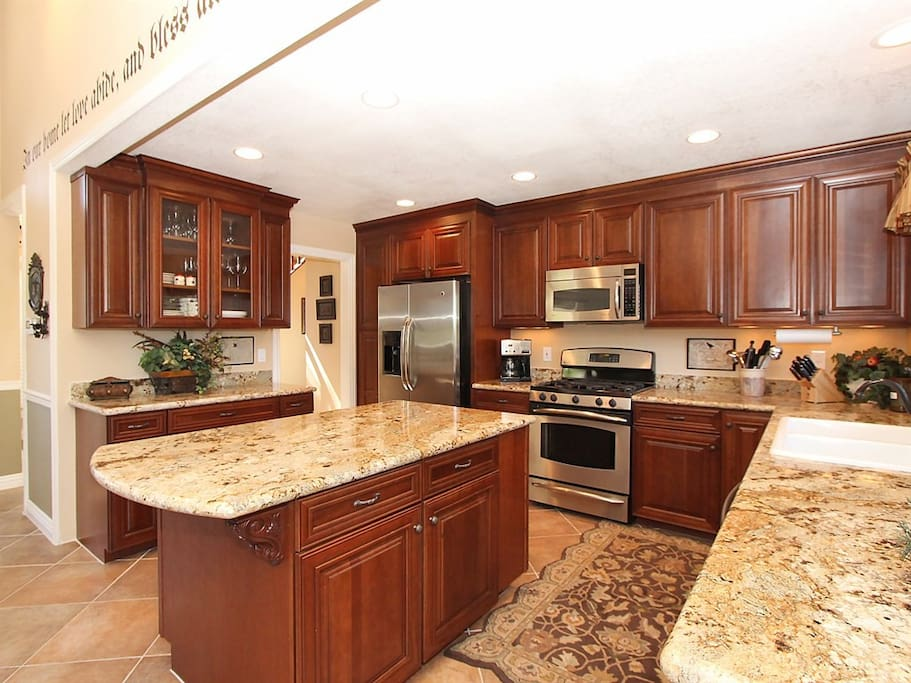 Kitchen island with a wonderful blend of wood, stone, and stainless.