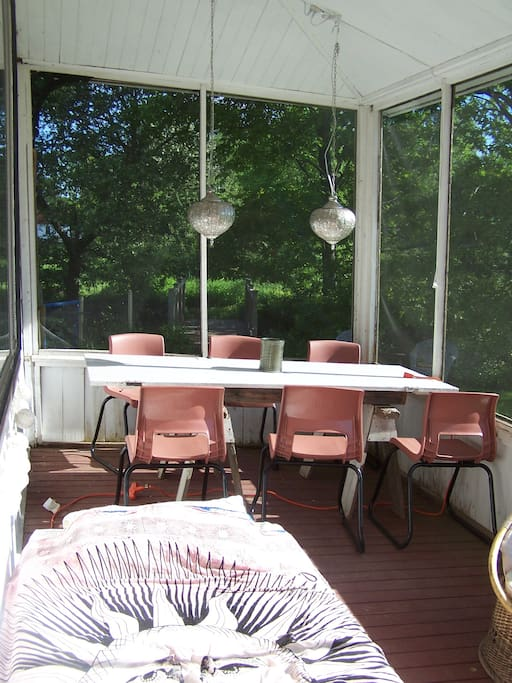 This lovely screened in porch is available for your dining or even just your hanging-out pleasure!