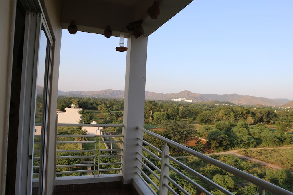 balcony with aravali hill view village life