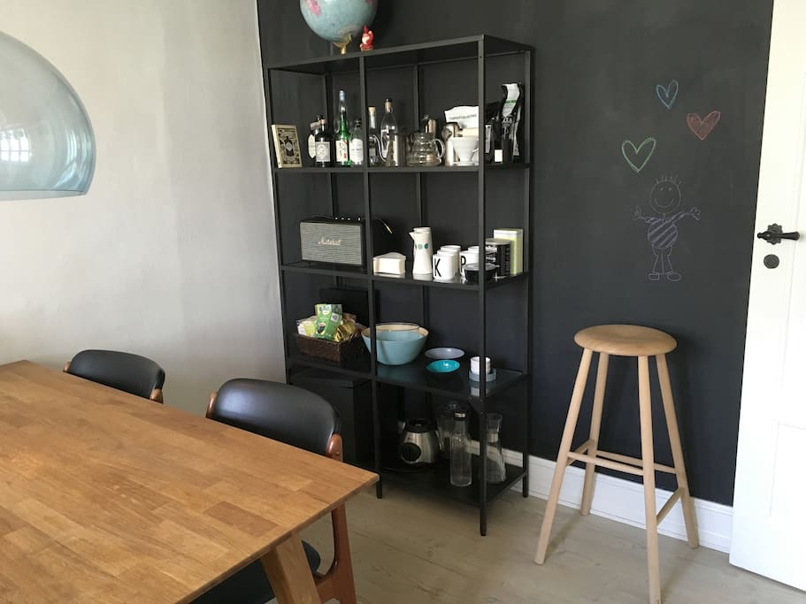 Our black wall is a big chalkboard - feel free to decorate it during your stay :)