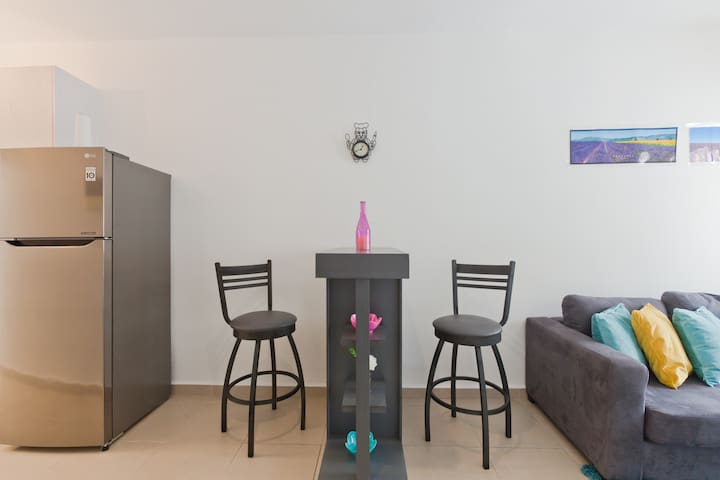 """A """"chic"""" bar stool, ideal to chill out in front of the TV with a glass of wine."""