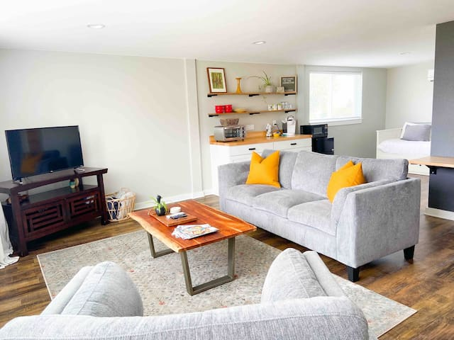 Spacious living space, with comfortable couches, and a large Roku tv.