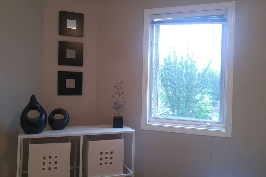 Bedroom - bright window and convenient shelving with storage