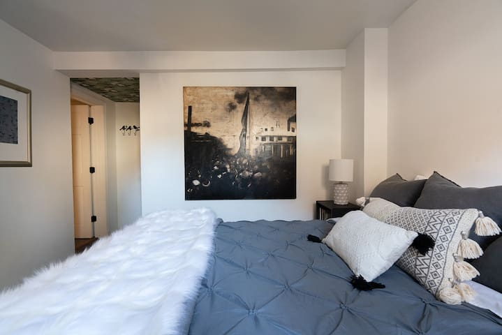 The bedroom features a comfortable organic mattress.