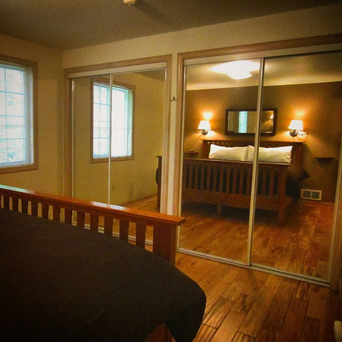 Another view of the Master Bedroom. We love how the mirrors open up the space!