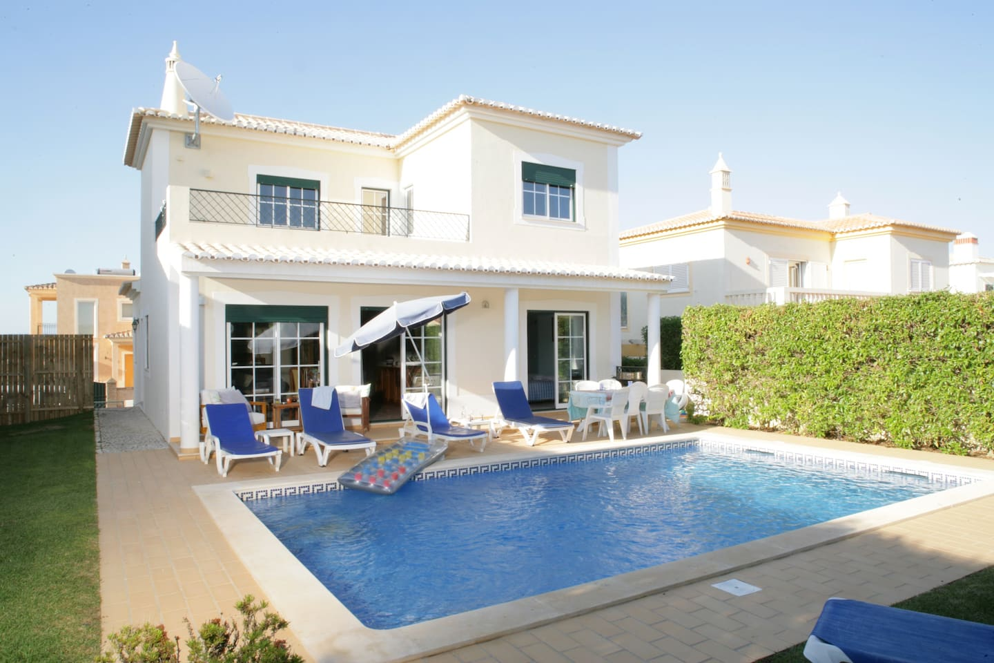 Pool area and terrace with sunloungers outdoor furniture and BBQ