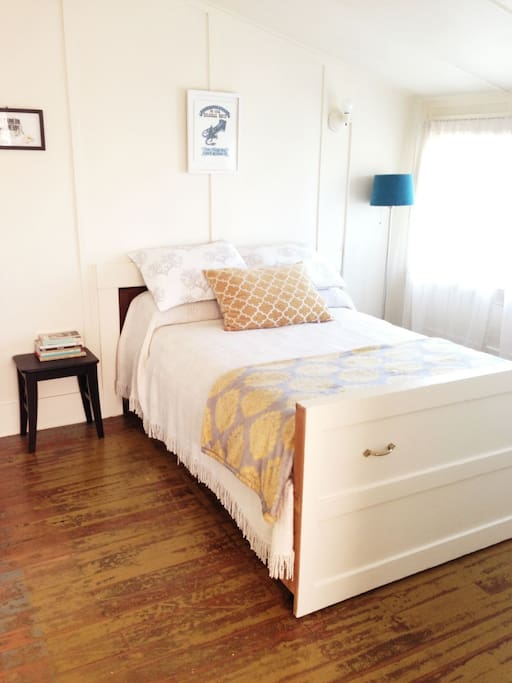 full sized bed in the Gertrude Stein room