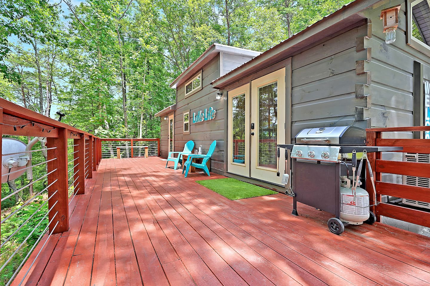 Relax on the 400 sq ft deck with BBQ grill, chairs and patio table led lighting all with great views!