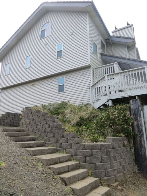 The house and the stairs into it.