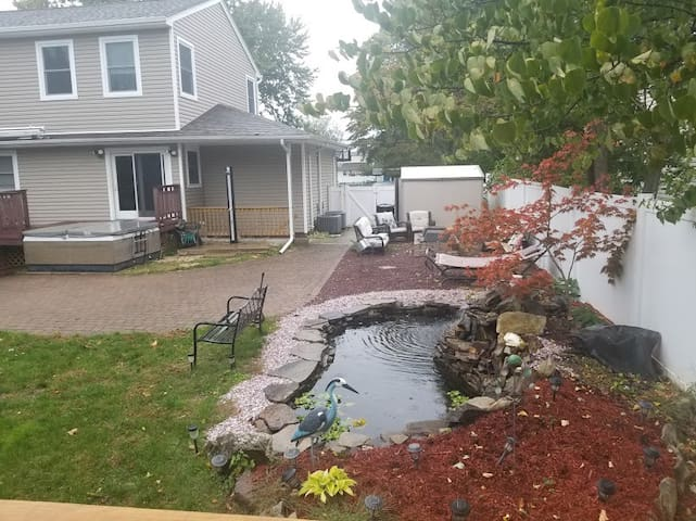 Your private entrance to the apartment and view of our lovely back yard