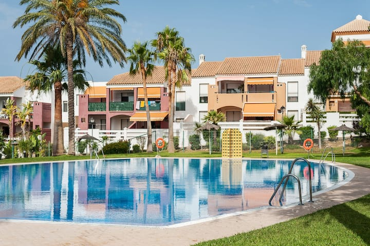 Air-Conditioned Apartment Close to Beach with Terrace, Pool, Garden & Wi-Fi; Parking Available