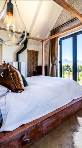 Main bedroom, Room 1, queen size bed. With balcony and views of all the stellenbosch and somerset west mountains.