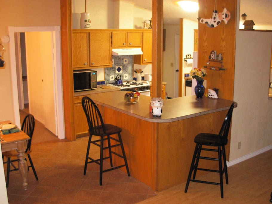 Breakfast bar overlooks the fully equipped kitchen providing a place to keep the cook company