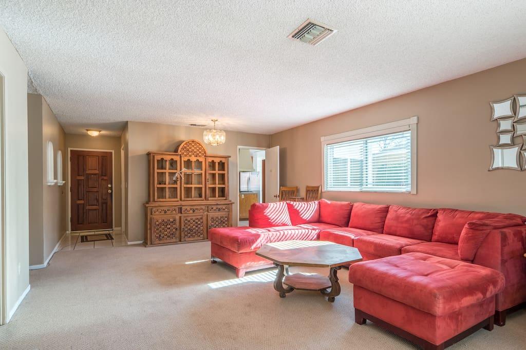 Spacious living room with plenty of sunshine.