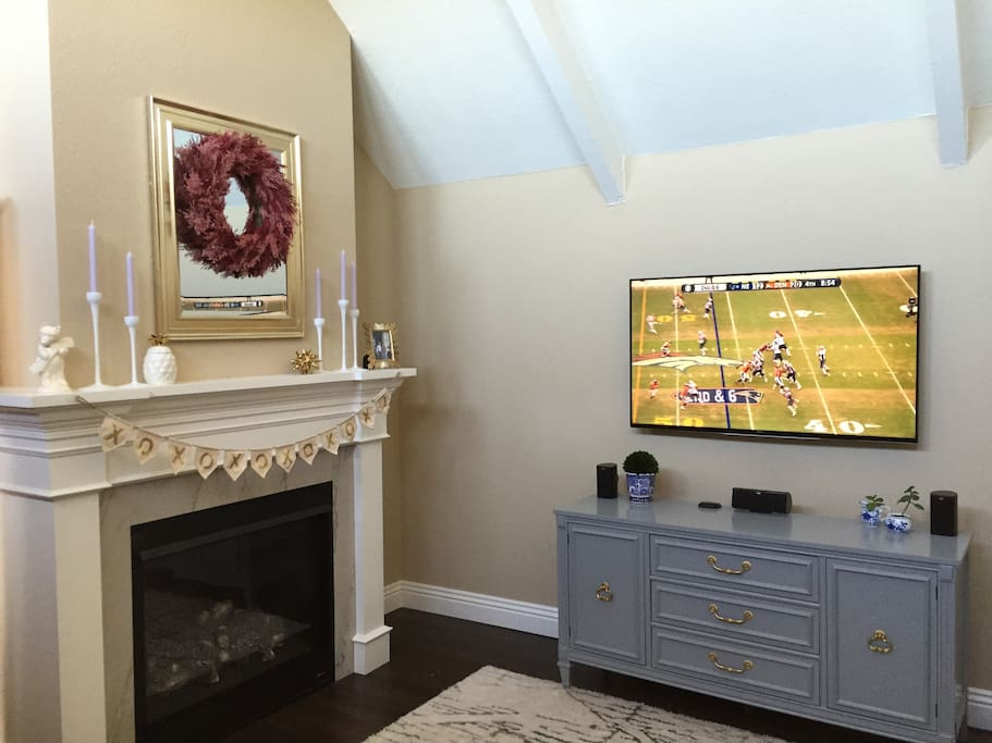 Gas fireplace and flat screen TV in the living room.
