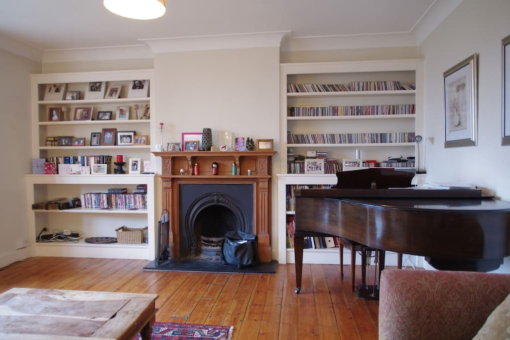 Baby grand and fire place fully functional