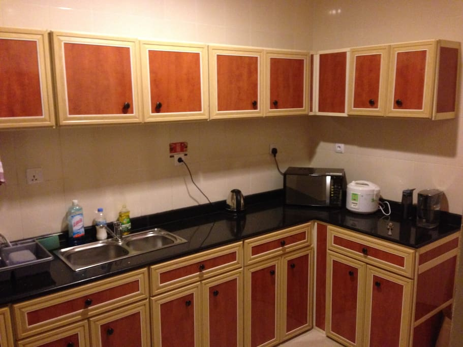 Full kitchen with Microwave, refrigerator, and stove.