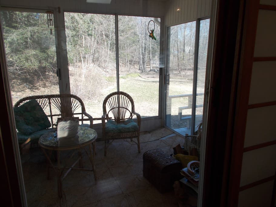Porch facing wooded backyard