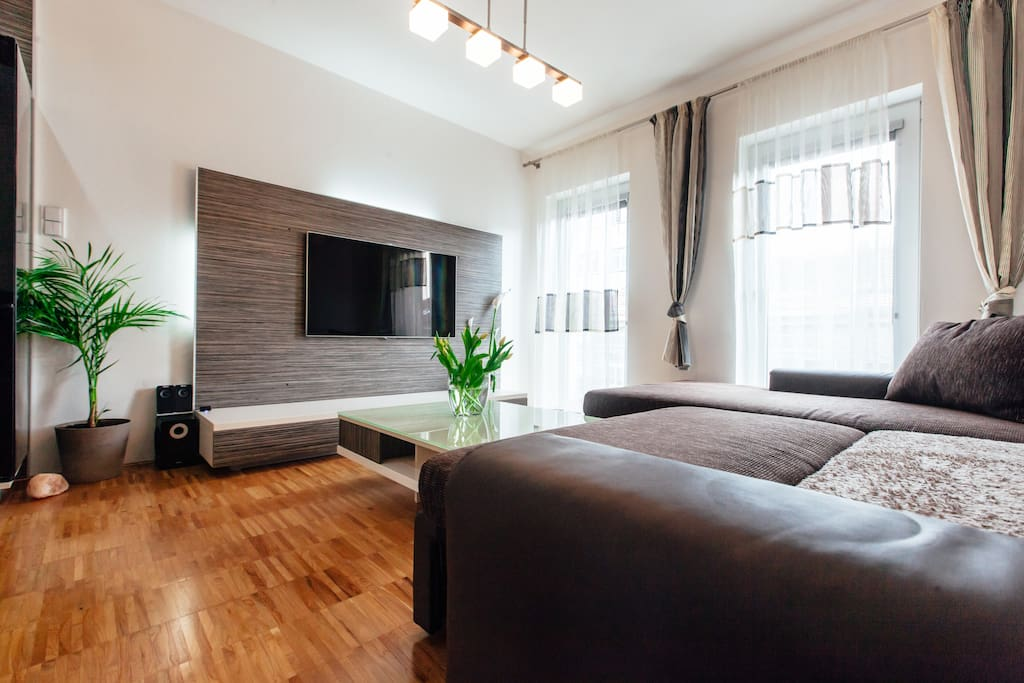 Living room with Large TV ( international channel selection & Apple TV available )