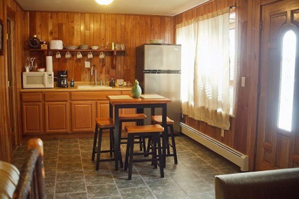 Eat in kitchenette with refrigerator, microwave and coffee pot.