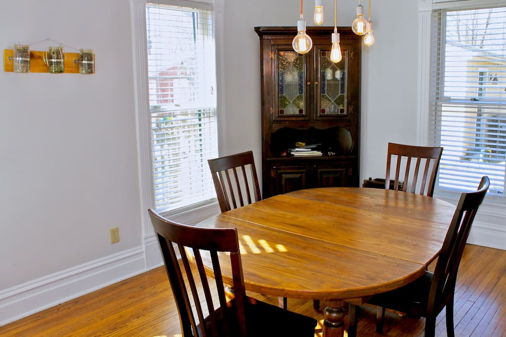 A spacious dining room with a table that seats up to 8.