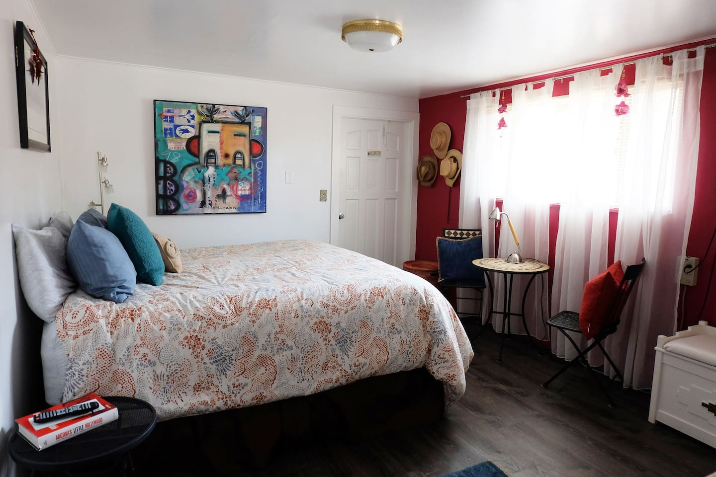 """Enjoy the Southwest artwork displayed throughout Red Rock Guest House with afternoon sun and natural light. Borrow a hat to hide from sun. Work or eat at bistro table.  Whatever you might need for your """"getaway"""" is at your fingertips."""