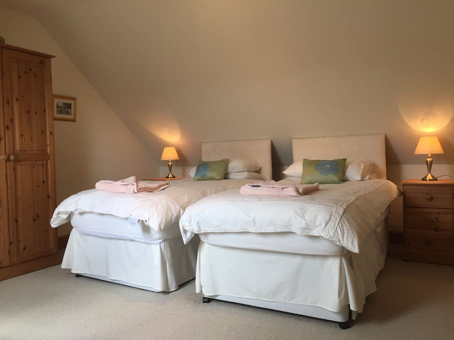 Our upstairs bedroom is made up as a twin but beds can be linked together to create another super king bed.  This bedroom also has an ensuite shower room.
