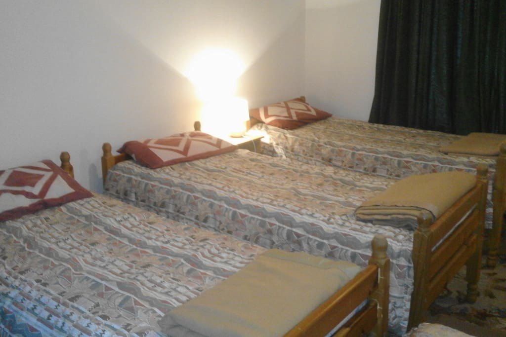 Room with three beds