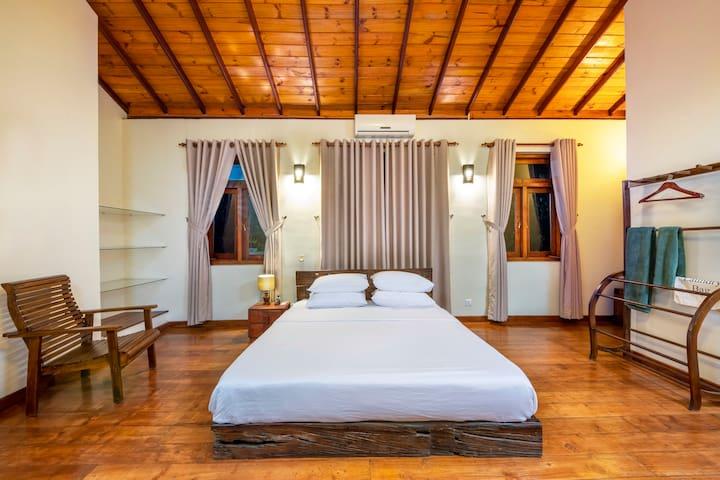 First floor master bed room (Bed room 1) - King bed - shelves - teak flooring - dresser - en-suite full bathroom - AC - Fan - wide windows - walk in closet (secured for owner)