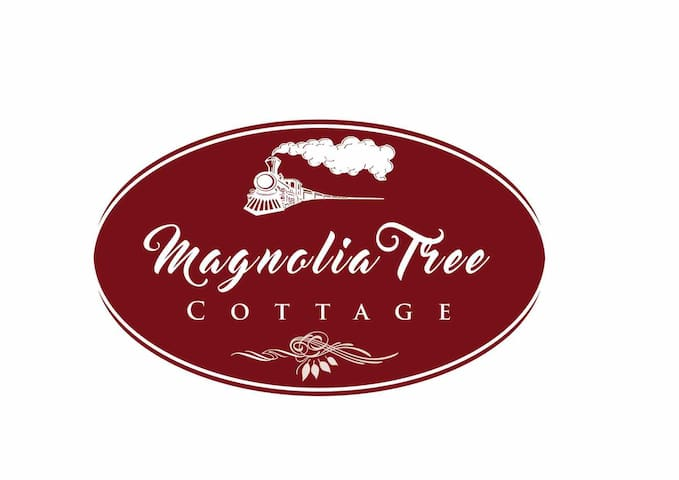 Our gorgeous Magnolia Tree Cottage logo, paying homage to the restored Steam Train, that is a well known land mark in Perth, Tasmania!