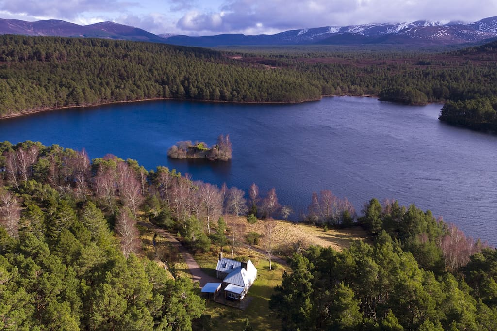 An aerial image of the cottage, loch, castle and mountains - simply breathtaking!