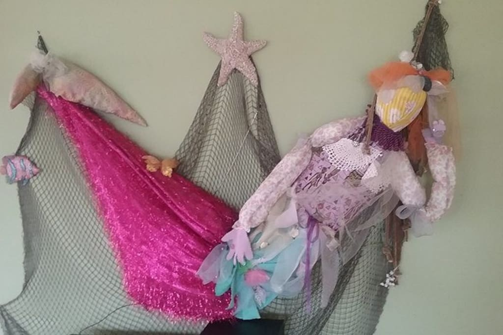 hand made mermaid to greet you while you enjoy your vacation