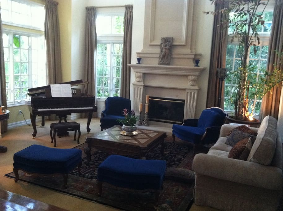 Living room with gas fireplace and player piano