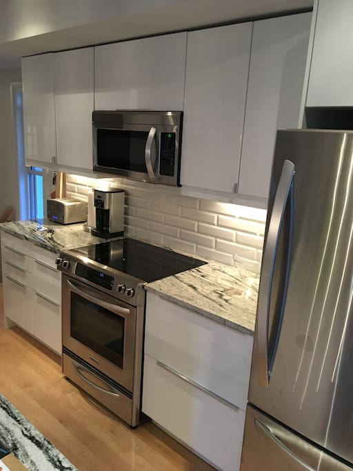 Fully equipped kitchen - coffee maker, kettle, blender, hand mixer, salad spinner, spices, teas & coffee. All new stainless steel appliances including dishwasher.