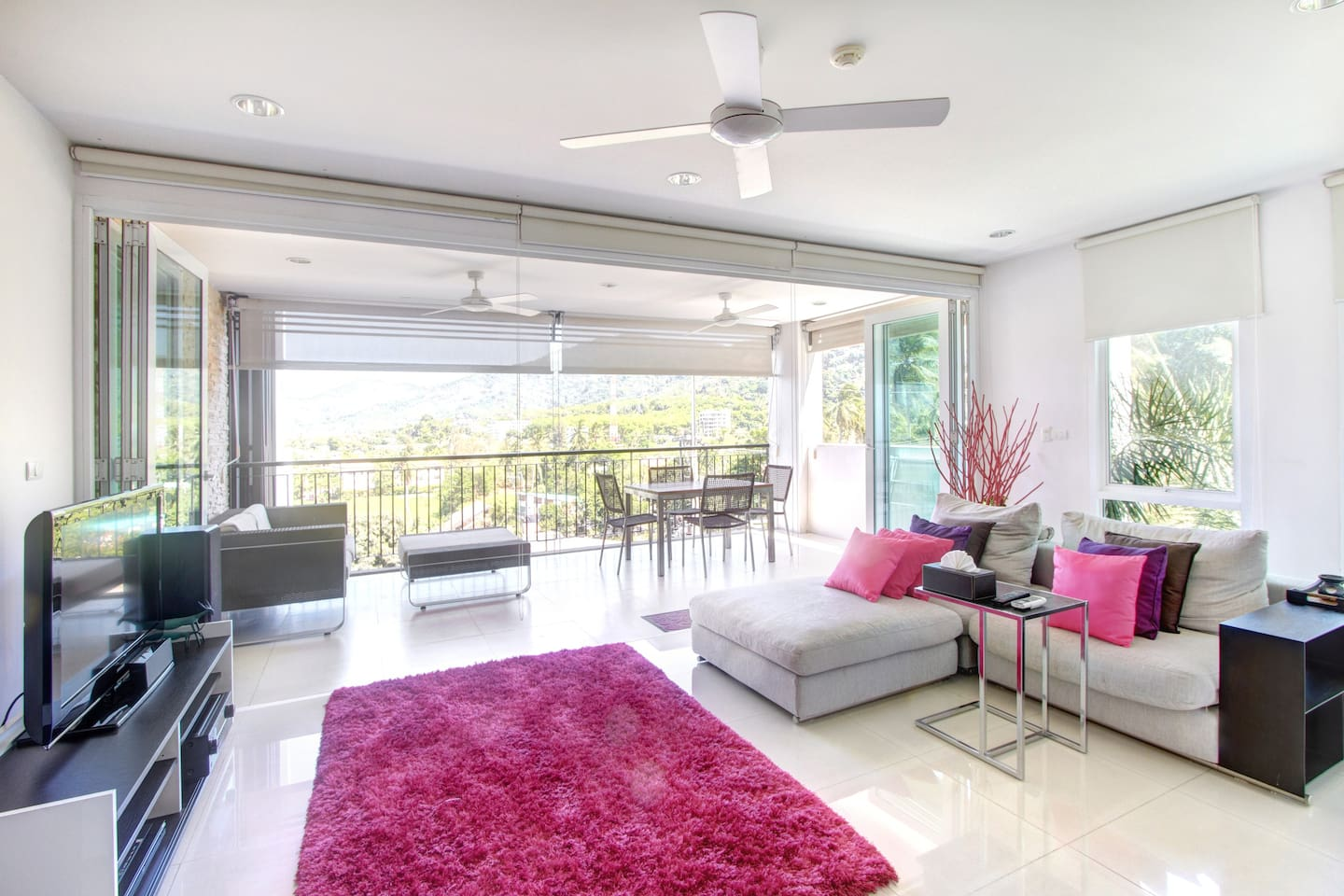 Spacious and bright living area, with swing doors that open to the balcony.